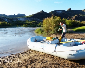 Tim, our guide getting the raft ready to launch.  Notice fast moving water of the Rio Grande.